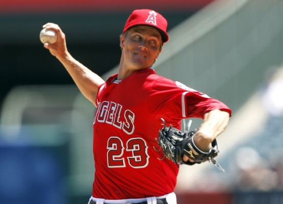 Los Angeles Angels starting pitcher Zack Greinke delivers against the Tampa Bay Rays during the first inning of a baseball game in Anaheim, Calif., Sunday, Aug. 19, 2012. (AP Photo/Alex Gallardo)